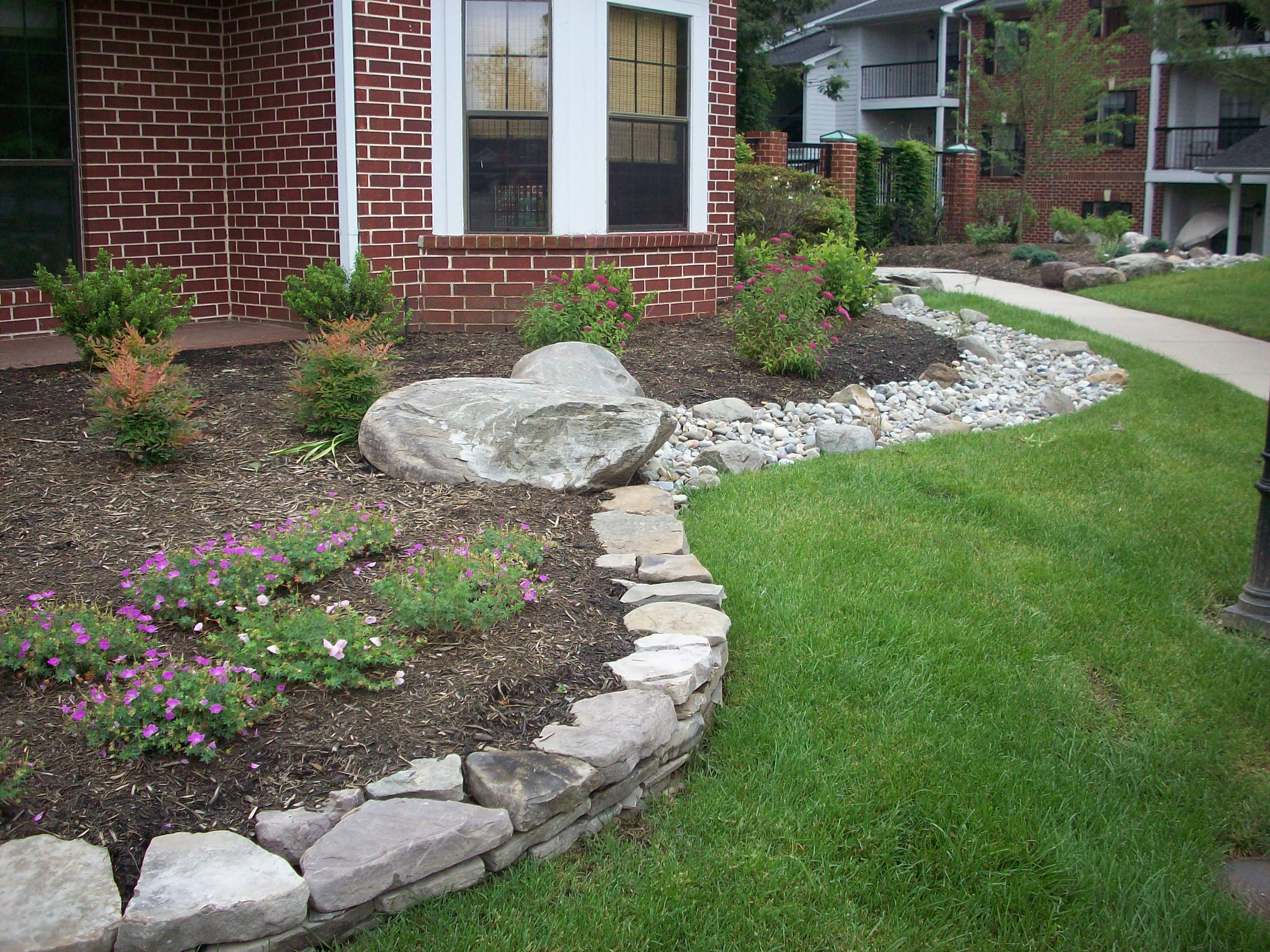 Main street landscape landscape design patios for Natural rock landscaping