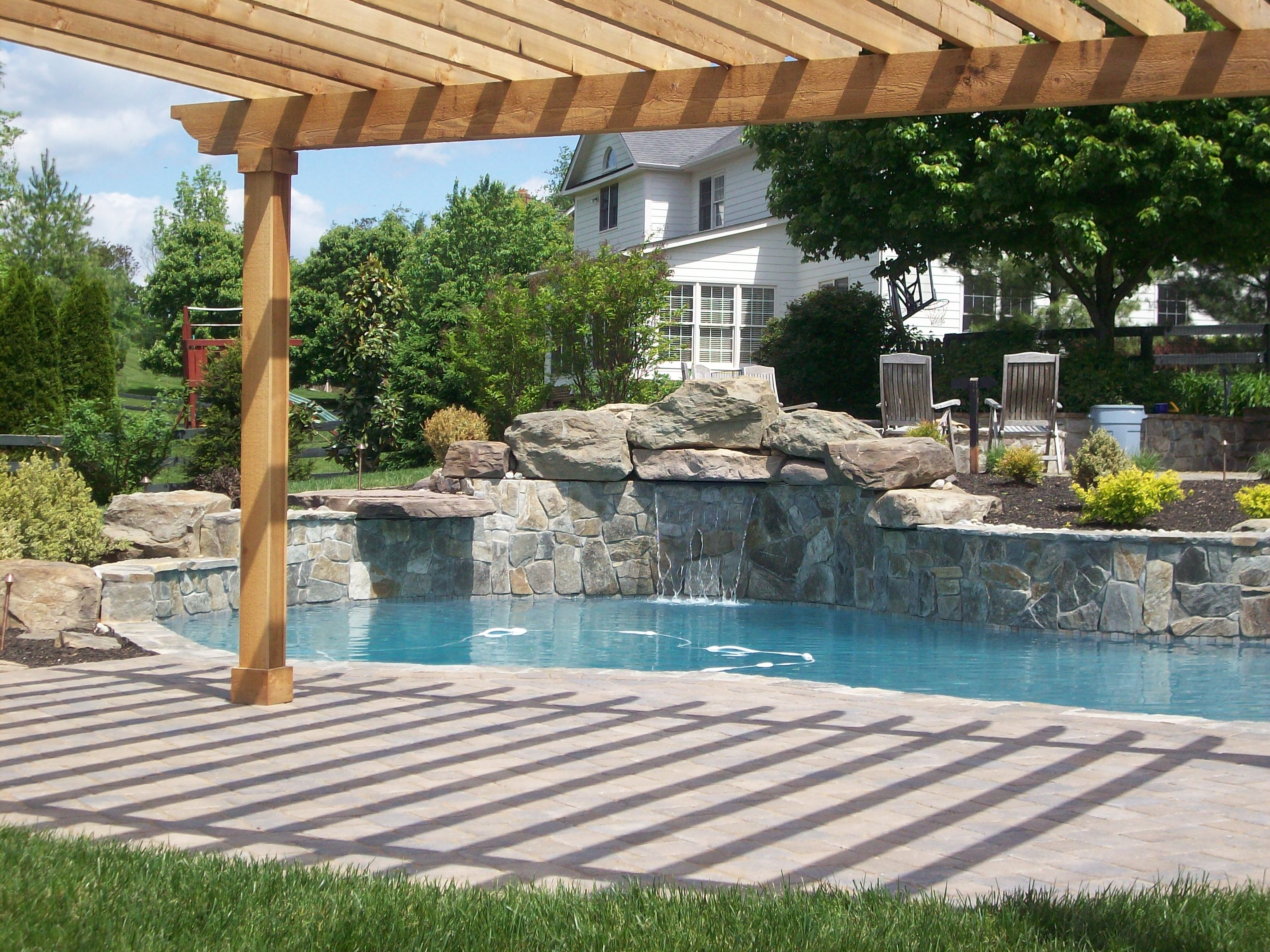 Boulders Around Pool A Pool As Part Of Your Back Yard Oasis  Main Street Landscape