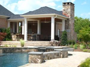 Swimming pool with masonry walls and falls